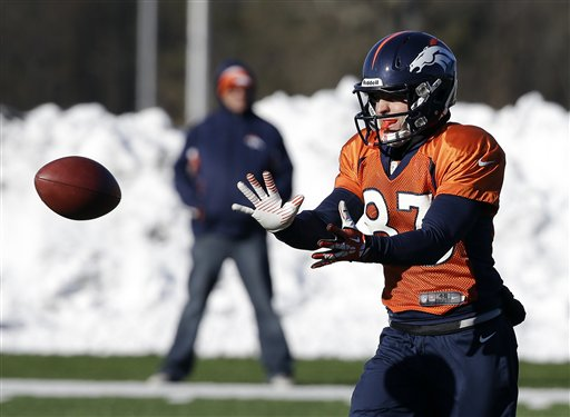 Denver Broncos wide receiver Wes Welker (83) catches a pass during practice Wednesday, Jan. 29, 2014, in Florham Park, N.J. (AP Photo/Mark Humphrey)