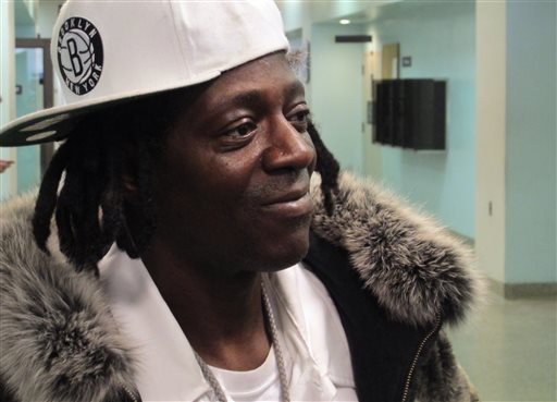 Flavor Flav speaks with reporters following an appearance in Nassau County District Court in Hempstead, N.Y., on Tuesday, Jan. 28, 2014. (AP Photo/Frank Eltman)