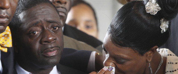 The parents of Ramarley Graham, Constance Malcolm, right, and Frank Graham, cry during a news conference outside the courthouse in New York, Wednesday, June 13, 2012. New York City Police Dept. officer Richard Haste has pleaded not guilty to manslaughter charges in the February shooting of Graham.  Police pursued Graham into his Bronx home during a drug investigation last February.  He was shot once at close range. (AP Photo/Seth Wenig)