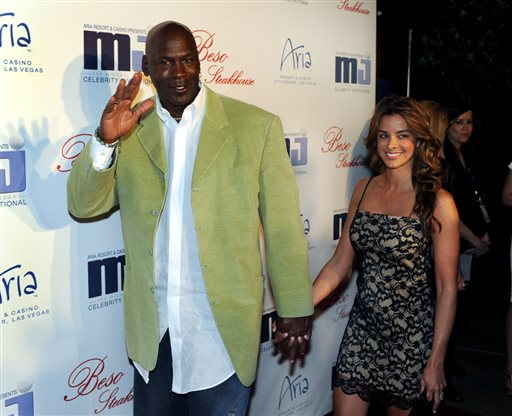 In this photo provided by the Las Vegas News Bureau, basketball great Michael Jordan and then-girlfriend Yvette Prieto arrive for a celebrity dinner at Beso inside Crystals in City Center in Las Vegas. (AP Photo/Las Vegas News Bureau, Brian Jones)