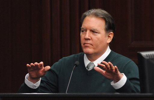 Michael Dunn, takes the stand in his own defense during his trial in Jacksonville, Fla., Tuesday, Feb. 11, 2014. Dunn is charged with fatally shooting 17-year-old Jordan Davis after an argument over loud music outside a Jacksonville, Fla. convenient story in 2012. (The Florida Times-Union, Bob Mack, Pool)