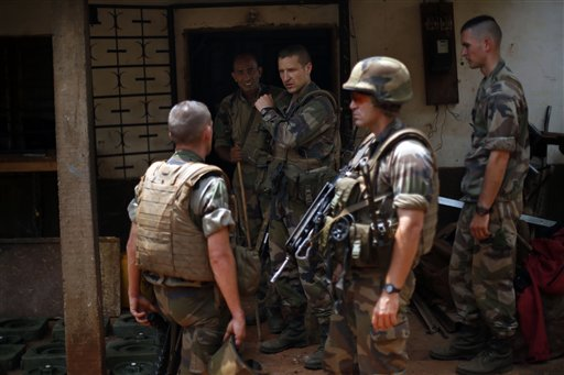 French soldiers search a house used as an armed cache in the Christian sector of PK12, the last checkpoint at the exit of the town, in Bangui, Central African Republic Tuesday Feb. 11, 2014 (AP Photo/Jerome Delay)