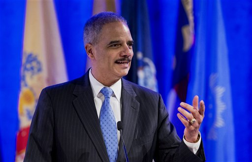 Attorney General Eric Holder speaks at the annual Attorneys General Winter Meeting in Washington, Tuesday, Feb. 25, 2014. Holder said state attorneys general are not obligated to defend laws in their states banning same sex-marriage if they don't believe in them.  (AP Photo/Manuel Balce Ceneta)