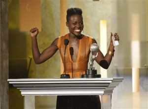 """Lupita Nyong'o accepts the award for outstanding supporting actress in a motion picture for """"12 Years a Slave"""" at the 45th NAACP Image Awards at the Pasadena Civic Auditorium on Saturday, Feb. 22, 2014, in Pasadena, Calif. (Photo by Chris Pizzello/Invision/AP)"""