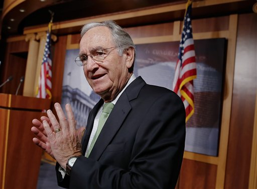 In this Nov. 7, 2013 file photo, Sen. Tom Harkin, D-Iowa speaks with reporters on Capitol Hill in Washington. (AP Photo/J. Scott Applewhite, File)