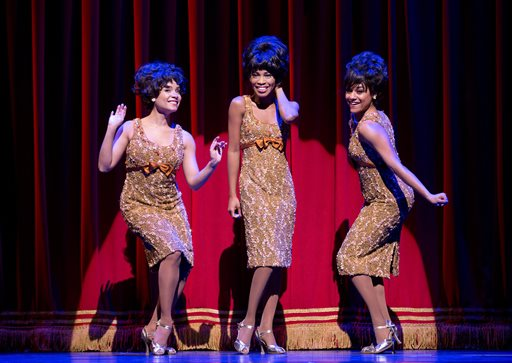 "This theater image released by Boneau/Bryan-Brown shows, from left, Sydney Morton as Forence Ballard, Valisia LeKae as Diana Ross and Ariana DeBose as Mary Wilson of The Supremes in ""Motown: The Musical,"" performing at the Lunt-Fontanne Theatre in New York. Producers of ""Motown the Musical"" said Thursday, Feb. 6, 2014, that the show's national tour will play Detroit''s Fisher Theatre for four-weeks between Oct. 21-Nov. 16. (AP Photo/Boneau/Bryan-Brown, Joan Marcus)"