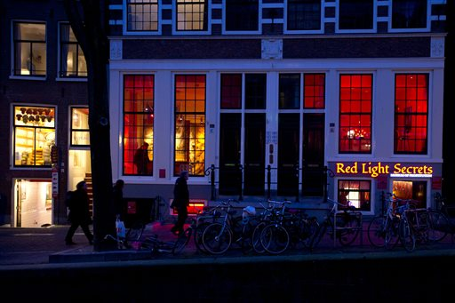 In this photo taken Tuesday, Feb. 4, 2014, the entrance of the 'Red Light Secrets' prostitution museum is seen, right, in Amsterdam. (AP Photo/Evert Elzinga)