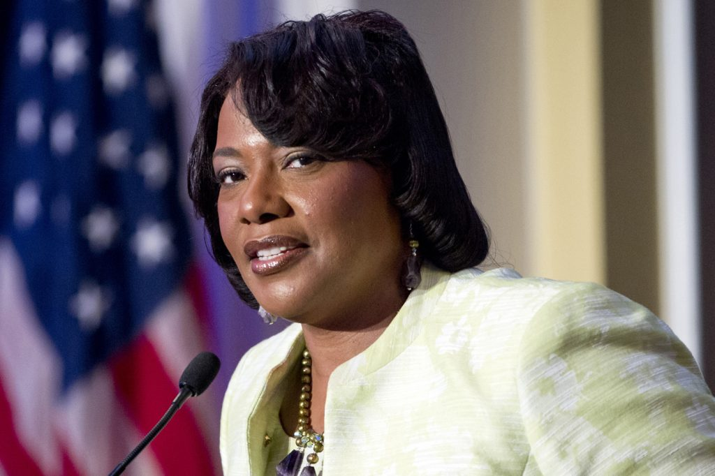 """Rev. Bernice King, the daughter of civil rights leader Martin Luther King Jr., speaks during a  """"I Have a Dream"""" Gospel Brunch at Willard Hotel in Washington Sunday,  Aug. 25, 2013. The brunch program highlights the music that inspired King during his lifetime and celebrates the historic speech he finished at the Willard Hotel in August 1963.  (AP Photo/Jose Luis Magana)"""