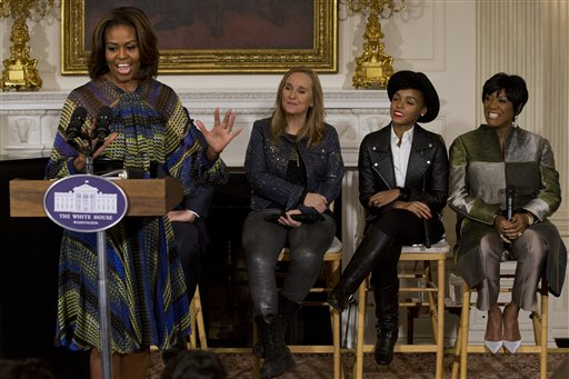 "First lady Michelle Obama speaks in the State Dining Room of the White House in Washington, Thursday, March 6, 2014, with singers, from second from left, Melissa Etheridge, Janelle Monáe, and Patti LaBelle, during a workshop for students as part of the ""In Performance at the White House"" series, celebrating female artists as the ""foremothers"" of American music. (AP Photo/Jacquelyn Martin)"