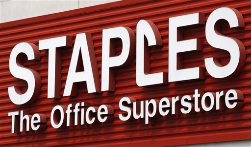 In this May 17, 2011 file photo, a Staples sign is displayed on the front of a Staple store, in Portland, Ore. (AP Photo/Rick Bowmer, File)