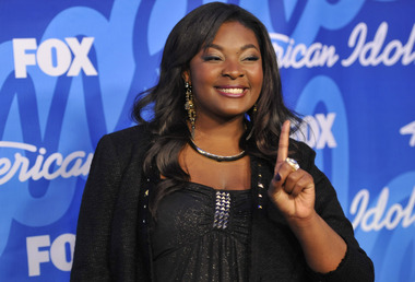 "Winner Candice Glover poses backstage at the ""American Idol"" finale at the Nokia Theatre at L.A. Live on Thursday, May 16, 2013, in Los Angeles. (Photo by Chris Pizzello/Invision/AP)"