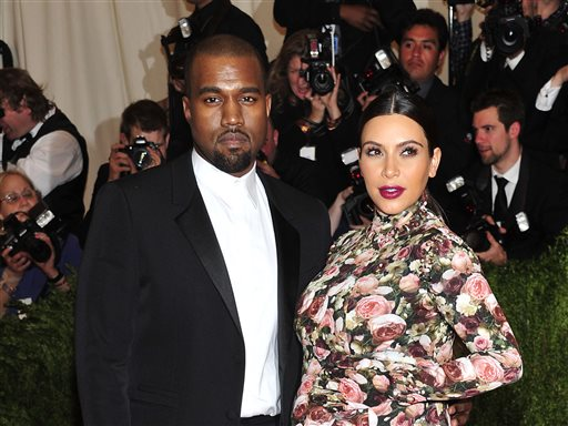 "In this May 6, 2013 file photo, Kanye West and Kim Kardashian attends The Metropolitan Museum of Art's Costume Institute benefit celebrating ""PUNK: Chaos to Couture"" in New York. A Los Angeles judge on Tuesday March 18, 2014, rejected a motion to dismiss a case filed by Kardashian and West against Chad Hurley, the co-founder of YouTube who posted video of their engagement on his new video-sharing website. (Photo by Charles Sykes/Invision/AP, File)"