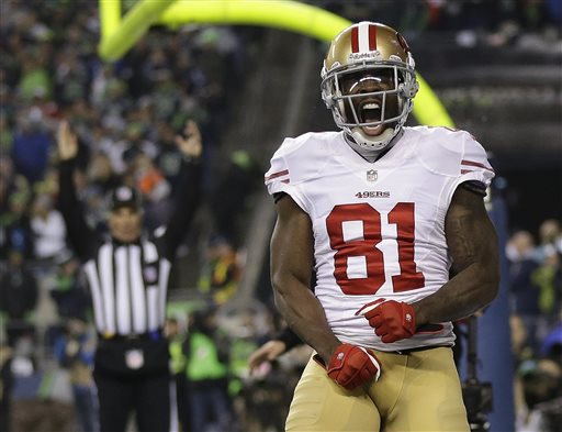 In this Jan. 19, 2014 file photo, San Francisco 49ers' Anquan Boldin celebrates his touchdown catch during the second half of the NFL football NFC Championship game against the Seattle Seahawks, in Seattle. (AP Photo/Marcio Jose Sanchez, File)