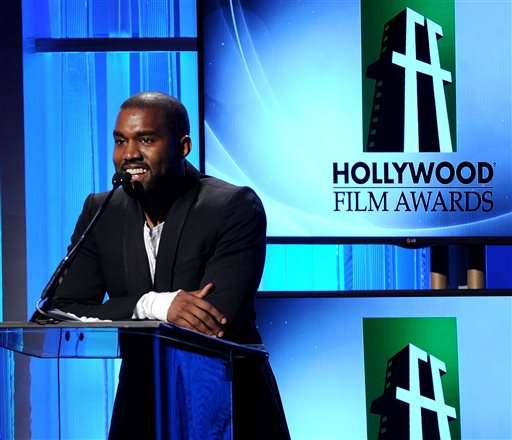 In this Oct. 22, 2013 file photo, recording artist Kanye West speaks onstage during the 17th Annual Hollywood Film Awards Gala at the Beverly Hilton Hotel in Beverly Hills, Calif.  West has pleaded no contest to misdemeanor battery against a photographer at Los Angeles International Airport last year in a special plea in which he maintains his innocence. (Photo by Frank Micelotta/Invision/AP, File)