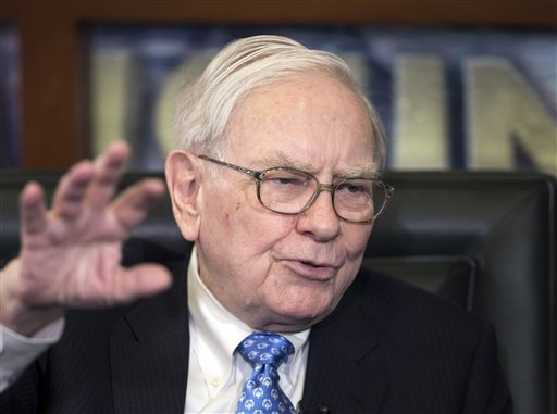 In this May 6, 2013 file photo, Berkshire Hathaway CEO and Chairman Warren Buffett speaks during an interview in Omaha, Neb. (AP Photo/Nati Harnik, File)