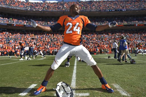 In this Jan. 19, 2014, photo, Denver Broncos cornerback Champ Bailey warms up before the AFC championship NFL playoff football game against the New England Patriots in Denver. In a cost-cutting move Thursday, March 6, 2014, the Broncos released Bailey, the team's defensive leader who's been a fan favorite since he was acquired in a trade with Washington in 2004. (AP Photo/Jack Dempsey)