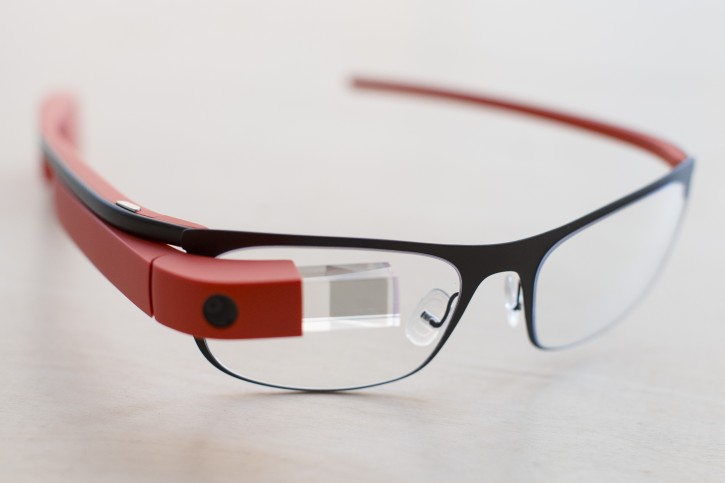 "The new Google Glass ""Thin"" prescription frames in ""tangerine"" color rests on a table at the Google Glass Basecamp space at Chelsea Market, Friday, Jan. 24, 2014, in New York. (AP Photo/John Minchillo)"