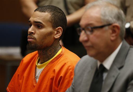 R&B singer Chris Brown, left, appears in Los Angeles Superior Court with his attorney Mark Geragos, on Monday, March 17, 2014. (AP Photo/Lucy Nicholson, Pool)