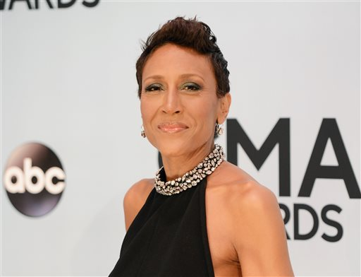 """This Nov. 6, 2013 file photo shows Robin Roberts at the 47th annual CMA Awards at Bridgestone Arena in Nashville, Tenn. Roberts will appear as a guest judge on ABC's """"Dancing With the Stars."""" (Photo by Evan Agostini/Invision/AP, File)"""