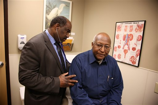 This photo taken Feb. 24, 2014, provided by the Roswell Park Cancer Institute, shows Dr. Willie Underwood, a urologic oncologist at Roswell Park Cancer Institute, examining patient Richard Waldrop at the Roswell Park Cancer Institute, in Buffalo, N.Y. (AP Photo/Roswell Park Cancer Institute, Bill Sheff)