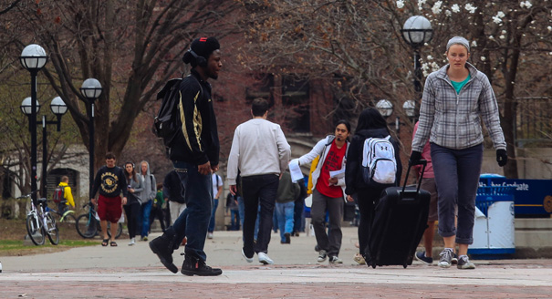 Students walk through the Ann Arbor campus of the University of Michigan on Tuesday, April 22, 2014, in Ann Arbor, Mich. The United States Supreme Court on Tuesday upheld Michigan's ban on affirmative action enacted by voters in 2006. (AP Photo/Detroit Free Press, Ryan Garza)