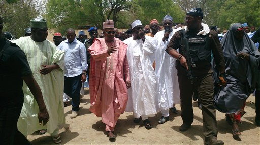 """In this photo taken  Monday, April, 21. 2014. Borno state governor Kashim Shettima, centre, visit  government secondary school Chibok, were gunmen abducted more than 200 students in Chibok, Nigeria. Nigerian parents say more than 200 girls and young women abducted from the  Chibok school by Islamic militants remain missing one week later, despite a """"hot pursuit"""" by security forces and an independent search by desperate parents who went into a dangerous forest. Dozens of the kidnapped girls managed to escape by jumping from the back of an open truck or hiding in dense forest.  (AP Photo/ Haruna Umar)"""