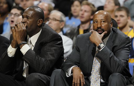 "In this March 13, 2013 file photo, New York Knicks head coach Mike Woodson, right, joins assistant coach Herb Williams in reacting as the Knicks fall behind to the Denver Nuggets in the third quarter of the Nuggets' 117-94 victory in an NBA basketball game in Denver. The Knicks have fired Woodson after falling from division champions to out of the playoffs in one season. New team president Phil Jackson made the decision Monday, April 21, 2014, saying in a statement ""the time has come for change throughout the franchise."" (AP Photo/David Zalubowski, File)"