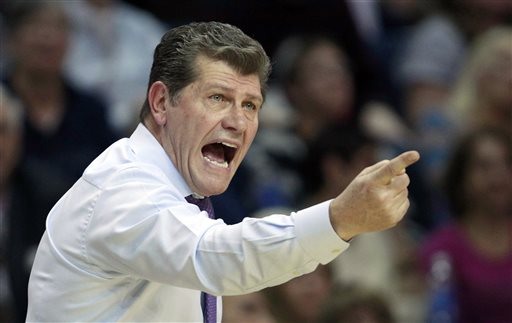 In this March 30, 2013 file photo, Connecticut head coach Geno Auriemma calls to his players during the first half of a women's NCAA college regional semifinal basketball game against Maryland in Bridgeport, Conn. Notre Dame and Connecticut are on an unprecedented collision course to meet in the national championship game.  (AP Photo/Charles Krupa, File)
