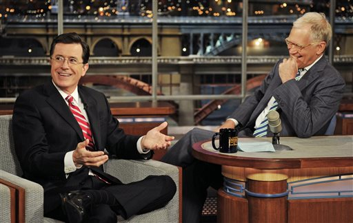 """In this May 3, 2012 photo provided by CBS, Stephen Colbert, left, host of the """"Colbert Report"""" on the Comedy Central Network, has a laugh on stage with host David Letterman on the set of the """"Late Show with David Letterman,"""" in New York. CBS announced on Thursday, April 10, 2014 that Colbert will replace Letterman as """"Late Show"""" host after Letterman retires in 2015. (AP Photo/CBS, John Paul Filo)"""