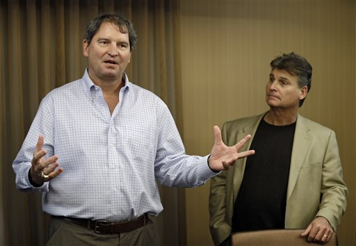 """In this Jan. 10, 2013 file photo, former Cleveland Browns quarterback Bernie Kosar, left, speaks at a news conference with Dr. Rick Sponaugle, in Middleburg Heights, Ohio . Thursday, Jan. 10, 2013. Kosar believes he's been unfairly sacked as a TV broadcaster. Kosar contends he's been removed because of slurred speech he attributes to """"a direct result of the many concussions I received while playing in the NFL."""" (AP Photo/Mark Duncan, File)"""