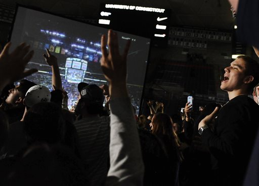 Connecticut fans celebrate after watching the broadcast of the team's 79-58 win over Notre Dame in the NCAA women's college basketball basketball tournament title game, Tuesday, April 8, 2014, in Storrs, Conn. (AP Photo/Jessica Hill)