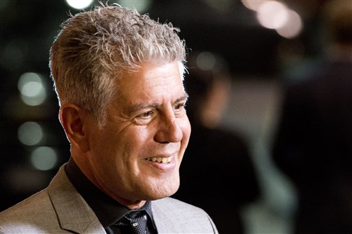 "In this Oct. 11, 2012 file photo, Anthony Bourdain attends ""On The Chopping Block: A Roast of Anthony Bourdain"" in New York. Bourdain's ""Parts Unknown"" series, a culinary travelogue, swiftly became CNN's top-rated series since debuting last April, a bright spot at a place that was in a severe dry spell before the missing Malaysian plane kicked up ratings. A new eight-episode season begins Sunday, April 13, 2014, at 9 p.m. EDT. (Photo by Charles Sykes/Invision/AP Images, File)"