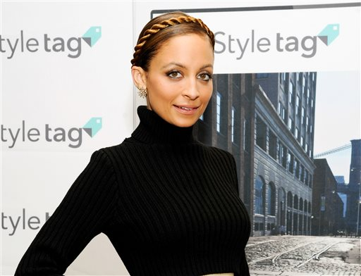 This Dec. 6, 2013 file photo shows TV personality and fashion designer Nicole Richie at the launch of SK Planet's Styletag fashion app at Henri Bendel in New York. Richie's #CandidlyNicole, based on her popular AOL web series, is coming to VH1 and will feature 8 new episodes premiering July 17.  (Photo by Evan Agostini/Invision/AP, File)