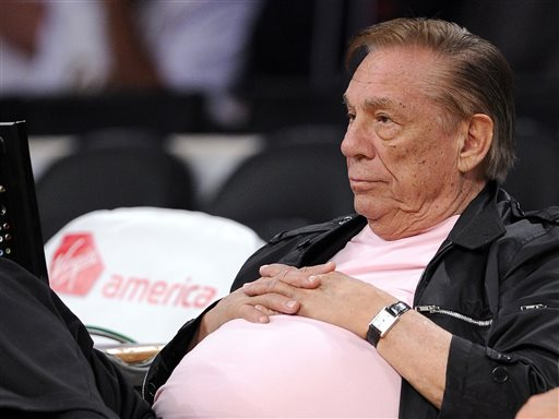 "In this Oct. 17, 2010 file photo, Los Angeles Clippers team owner Donald Sterling watches his team play in Los Angeles. The NBA is investigating a report of an audio recording in which a man purported to be Sterling makes racist remarks while speaking to his girlfriend.  NBA spokesman Mike Bass said in a statement Saturday, APril 26, 2014, that the league is in the process of authenticating the validity of the recording posted on TMZ's website. Bass called the comments ""disturbing and offensive.""  (AP Photo/Mark J. Terrill, File)"