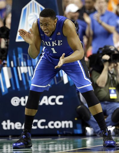 In this March 16, 2014 file photo, Duke's Jabari Parker (1) celebrates after making a basket against Virginia during the second half of an NCAA college basketball game in the championship of the Atlantic Coast Conference tournament in Greensboro, N.C. Parker was selected to The Associated Press All-America team, released Monday, March 31, 2014.  (AP Photo/Gerry Broome)