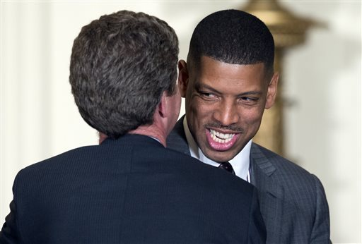 In this Jan. 23, 2014 file photo, Housing and Urban Development Secretary Shaun Donovan, left, talks with Sacramento Mayor Kevin Johnson, before President Barack Obama arrives to speak at a reception for the U.S. Conference of Mayors in the East Room of the White House in Washington. (Carolyn Kaster/AP)