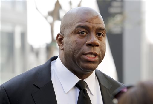 "In this Feb. 21, 2013, file photo, former Los Angeles Lakers player Earvin ""Magic"" Johnson arrives at a memorial service for Jerry Buss in Los Angeles. Johnson is calling upon NBA Commissioner Adam Silver to ""come down hard"" on Los Angeles Clippers owner Donald Sterling, who is alleged to have made racially charged comments. Johnson was a subject of the comments Sterling allegedly made on an audio recording obtained and released by TMZ. (AP Photo/Reed Saxon, File)"