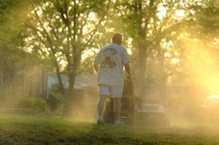 In a Monday, April 5, 2010 photo, Shane Nantz kicks up a cloud of pollen as he mows the front yard of his west Charlotte, N.C., home. (AP Photo/The Charlotte Observer, Todd Sumlin)