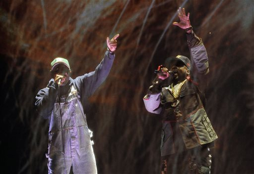 Andre 3000, left, and Big Boi of hip hop group Outkast perform behind a screen during their headlining set on the first day of the 2014 Coachella Music and Arts Festival on Friday, April 11, 2014, in Indio, Calif. (Photo by Chris Pizzello/Invision/AP)