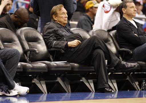 In this April 4, 2010, file photo, Los Angeles Clippers owner Donald Sterling sits courtside during the NBA basketball game between the New York Knicks and the in Los Angeles. NBA Commissioner Adam Silver Silver announced Tuesday, April 298, 2014, that Sterling has been banned for life by the league, in response to racist comments the league says he made in a recorded conversation.(AP Photo/Danny Moloshok, File)