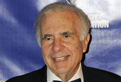 In this March 16, 2010 file photo, financier Carl Icahn poses for photos upon arriving for the 32nd annual New York City Police Foundation Gala in New York. Under a deal announced Thursday, April 10, 2014, Icahn is backing down from his push to remake eBay, settling an acrimonious dispute just ahead of what promised to be an awkward annual shareholders meeting. (AP Photo/Henny Ray Abrams, File)