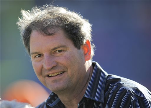 """In this Dec. 23, 2012 file photo, former Cleveland Browns quarterback Bernie Kosar stands on the sideline before of an NFL football game between the Browns and Denver Broncos, in Denver. Kosar believes he's been unfairly sacked as a TV broadcaster. Kosar contends he's been removed because of slurred speech he attributes to """"a direct result of the many concussions I received while playing in the NFL."""" (AP Photo/Jack Dempsey, File)"""