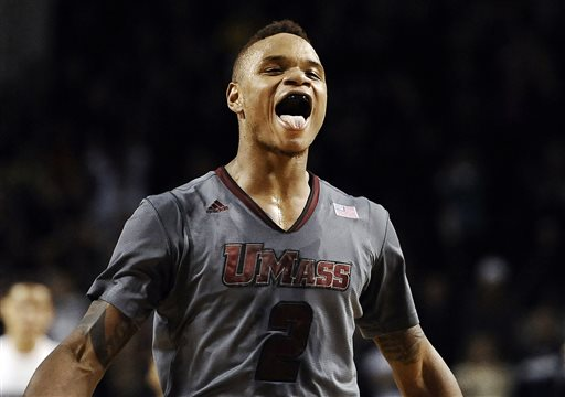 In this Dec. 28, 2013 file photo, UMass guard Derrick Gordon celebrates after hitting the go-ahead basket with one second left on the clock during overtime of an NCAA college basketball game against Providence, in Amherst, Mass. Gordon says in a televised interview that he is gay. Gordon made the announcement on ESPN on Wednesday, April 9, 2014, becoming the first openly gay player in Division I men's basketball.  (AP Photo/Jessica Hill, File)