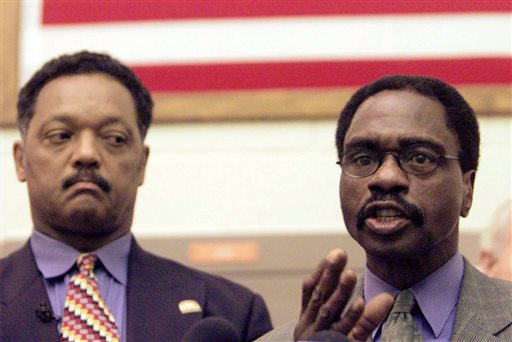 """In this March 3, 2000 file photo, the Rev. Jesse Jackson, left, listens as Rubin """"Hurricane"""" Carter, the former middleweight boxer, speaks during a news conference inside the North County Correctional Facility in Castaic, Calif. Carter, who spent almost 20 years in jail after twice being convicted of a triple murder he denied committing, died at his home in Toronto, Sunday, April 20, 2014, according to long-time friend and co-accused John Artis. He was 76. (AP Photo/Damian Dovarganes, File)"""