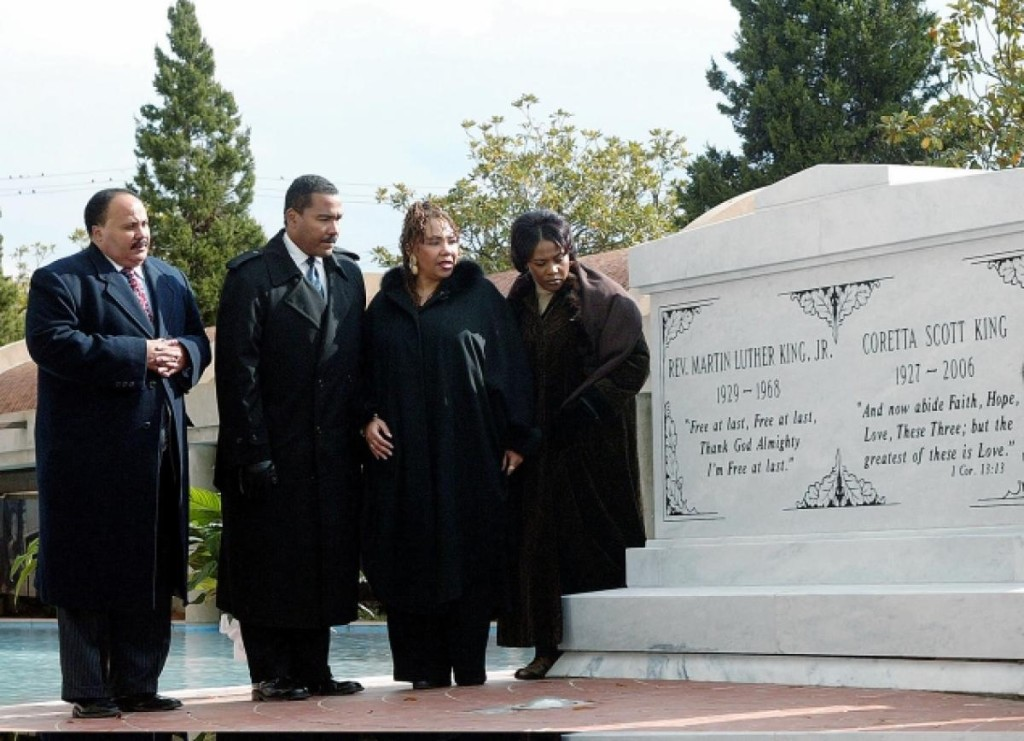 From left to right, Martin Luther King III, Dexter King, the late Yolanda King and Bernice King, stand next to a crypt dedicated to their parents, the Rev. Martin Luther King Jr. and Coretta Scott King, in 2006. (WILFRED HAREWOOD/AP)