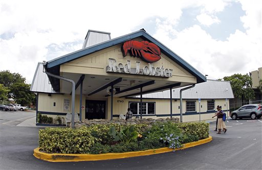 This Thursday, Sept. 6, 2012, file photo, shows a Red Lobster restaurant in Hialeah, Fla. Darden Restaurants on Friday, May 16, 2014 said it entered an agreement to sell its Red Lobster chain to investment firm Golden Gate Capital in a $2.1 billion cash deal. (AP Photo/Alan Diaz, File)