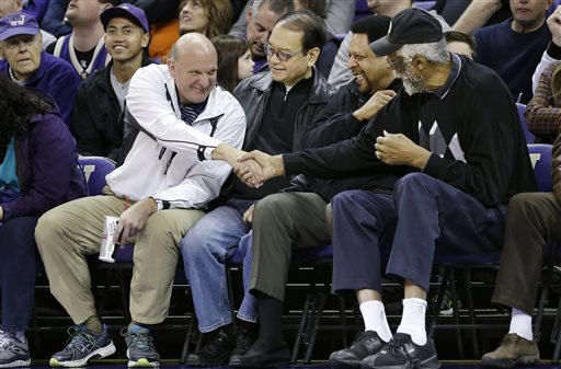 """In this Jan. 25, 2014, photo, then-Microsoft CEO Steve Ballmer, left, shakes hands with former NBA players Bill Russell, right, and """"Downtown"""" Freddie Brown as Omar Lee looks on during an NCAA college basketball game between Washington and Oregon State in Seattle. An individual with knowledge of negotiations to sell the Los Angeles Clippers said Shelly Sterling has reached an agreement to sell the team to Ballmer for $2 billion. The individual, who wasn't authorized to speak publicly, told The Associated Press on Thursday, May 29, 2014, that Ballmer and the Sterling Family Trust now have a binding agreement. The deal now must be presented to the NBA. (AP Photo/Elaine Thompson, File)"""