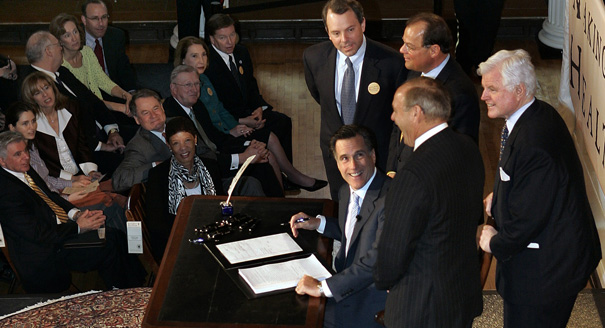 "In this April 12, 2006, file photo Massachusetts Gov. Mitt Romney, reacts at Faneuil Hall in Boston after signing into law his landmark health care bill, designed to guarantee health insurance to virtually all Massachusetts residents. The law provided a blueprint for President Barack Obama's health care law, which Romney has vowed to dismantle. Ironically the ""Romneycare"" vs. ""Obamacare"" debate has given Romney with his most succinct retort, that issues of health care should be left to the states, not the federal government. (AP Photo/Elise Amendola, File)"