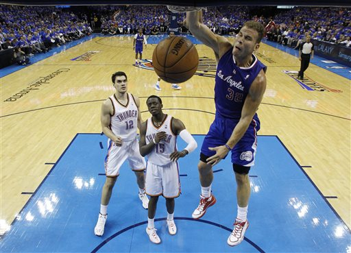 Los Angeles Clippers forward Blake Griffin (32) dunks in front of Oklahoma City Thunder center Steven Adams (12) and guard Reggie Jackson (15) in the third quarter of Game 1 of the Western Conference semifinal NBA basketball playoff series in Oklahoma City, Monday, May 5, 2014. Los Angeles won 122-105. (AP Photo/Sue Ogrocki)