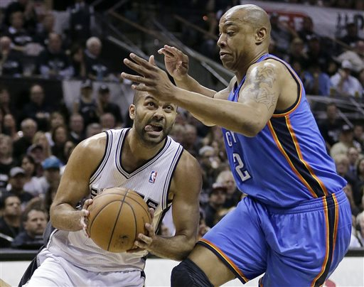San Antonio Spurs' Tony Parker, left, of France, drives around Oklahoma City Thunder's Caron Butler (2) during the first half of Game 1 of a Western Conference finals NBA basketball playoff series, Monday, May 19, 2014, in San Antonio. (AP Photo/Eric Gay)